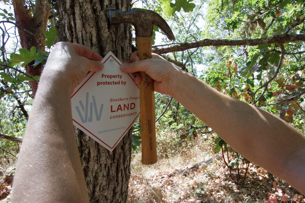 "Karen installs boundary markers to inform visitors of the land's conservation status.         Normal   0             false   false   false     EN-US   X-NONE   X-NONE                                                                                                                                                                                                                                                                                                                                                                                                                                                                                                                                                                                                                                                                                                                                                                                                                                                                 /* Style Definitions */  table.MsoNormalTable 	{mso-style-name:""Table Normal""; 	mso-tstyle-rowband-size:0; 	mso-tstyle-colband-size:0; 	mso-style-noshow:yes; 	mso-style-priority:99; 	mso-style-parent:""""; 	mso-padding-alt:0in 5.4pt 0in 5.4pt; 	mso-para-margin:0in; 	mso-para-margin-bottom:.0001pt; 	mso-pagination:widow-orphan; 	font-size:12.0pt; 	font-family:""Cambria"",serif; 	mso-ascii-font-family:Cambria; 	mso-ascii-theme-font:minor-latin; 	mso-hansi-font-family:Cambria; 	mso-hansi-theme-font:minor-latin; 	mso-ansi-language:ES-TRAD;}"