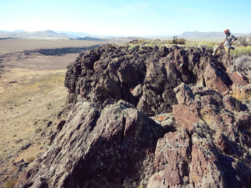 Rock outcrops with a view of the basin and range.