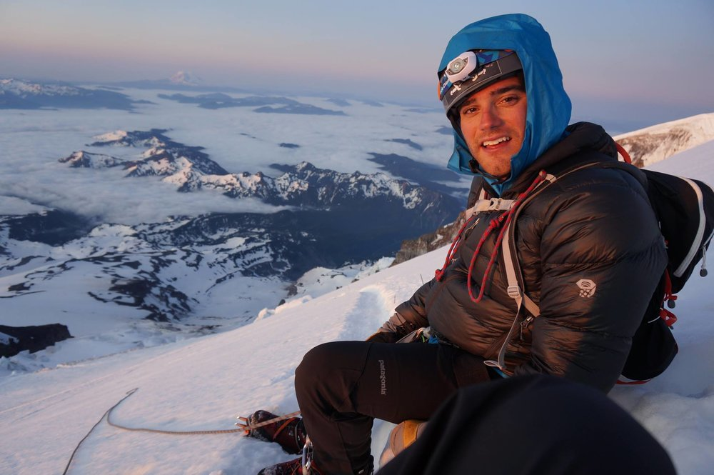 Andrew at the summit of Mt. Rainier (14,410') in 2013.