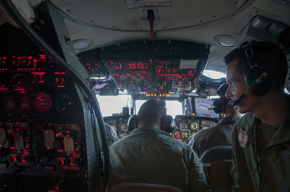 Hungarian Defense Force Lieutenant Tamás Molmòr, sits in the cockpit of an Antonov-26 cargo plane waiting to receieve messages from the control tower before lift-off in Kecskemét, Hungary on June 8, 2015.