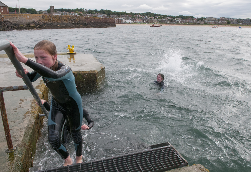 Isabelle Bridge exits the water after a dive into the Firth of Forth Sea with her family off the shore of North Berwick, Scotland on July 21, 2015.