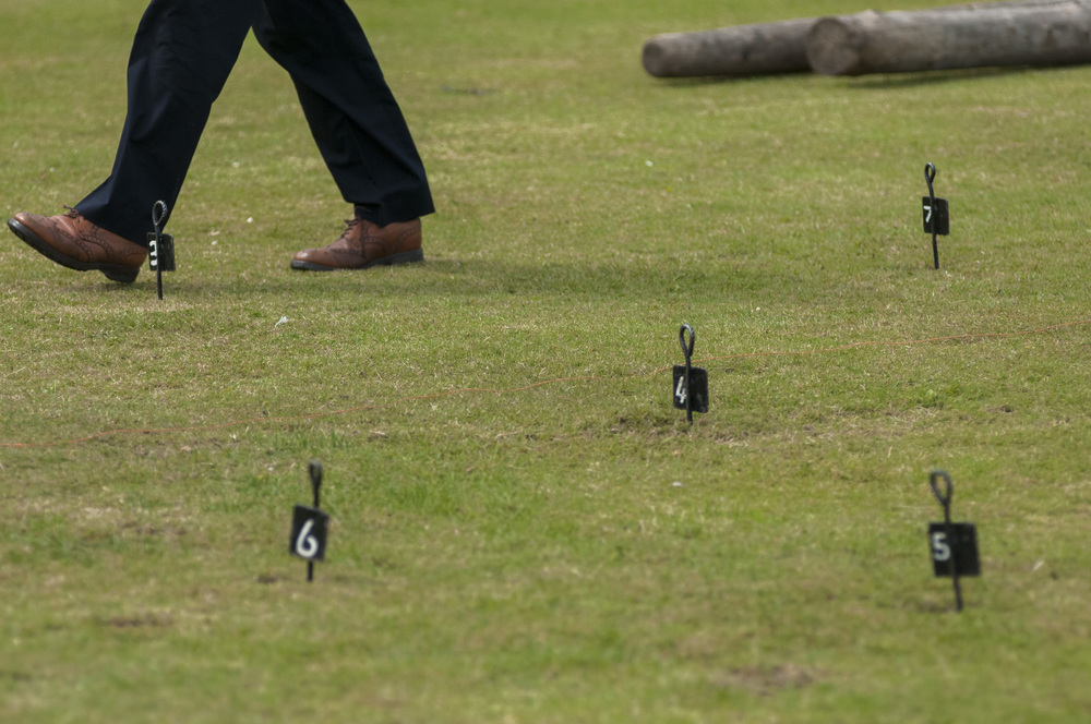 A referee of the stone put event walks off the field after measuring a throw during the men's competition at the St. Andrews Highland Games on July 26, 2015 in St. Andrews, Scotland.