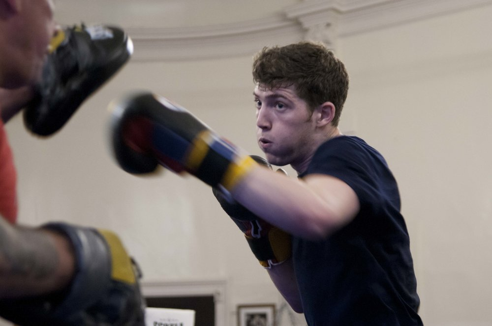 Matt Baines throws a punch in the ring at the Leith Victoria AAC Boxing Club in Leith, Scotland during a practice session on Aug. 4, 2015. Founded in 1919, Leith Victoria AAC is the oldest boxing club in Scotland.