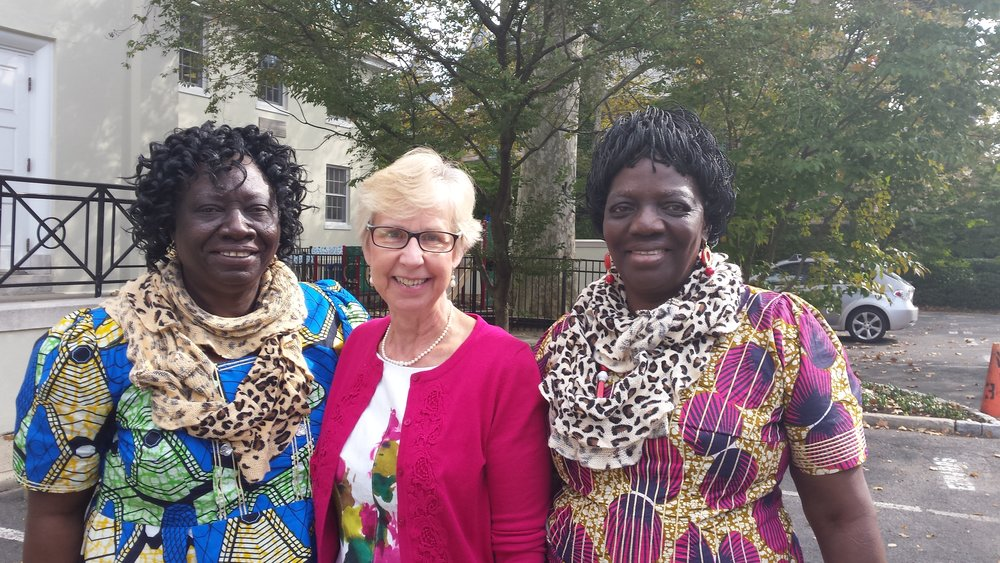 "The Rev. Joyce MacKichan Walker welcomes at Nassau Presbyterian Church; Maman Antoinette told (demonstrating her English!) about ""Mata"" who lives well with AIDS, thanks to FEBA."