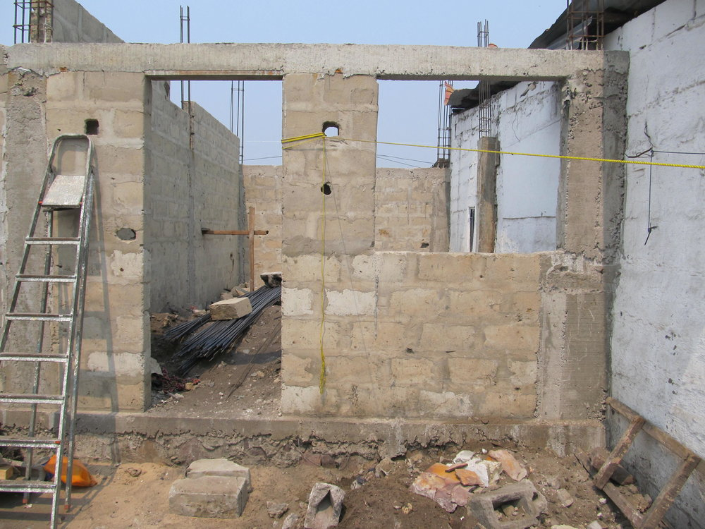 July 2015: There are no exterior windows at ground level except on the street front since adjacent properties come right up to the walls of the Center & safety requires solid cement block walls. Ventilation spaces are set just under the roof line.