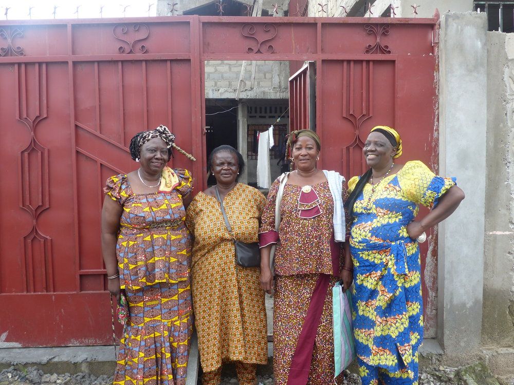 Mme Monique & some colleagues before the front gate of the Center, which is set into concrete walls surrounding the building.