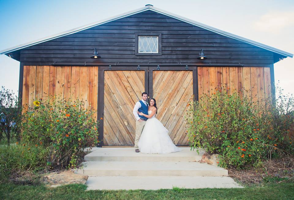 couple in front of barn.jpg