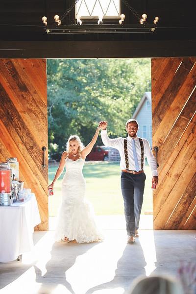 bride and groom entering barn.jpg