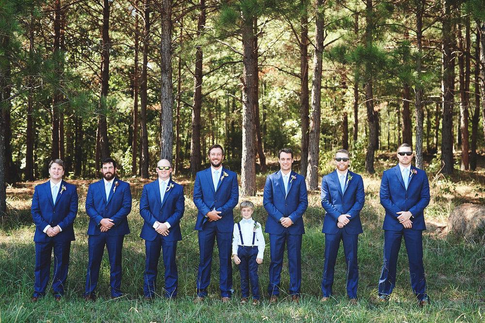 groomsmen in woods.jpg