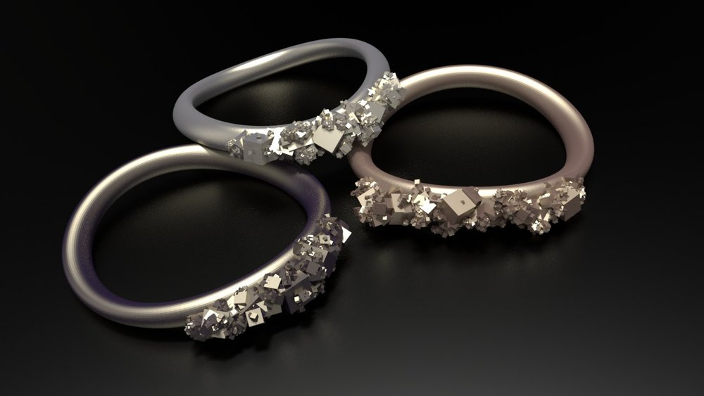 bronze, silver, and steel band rings layered.jpg