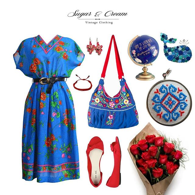 A La Kimono . This cotton dress is simply unique. Red flowers decorate the bright blue piece, running along the skirts hem and bodice. One is instantly drawn to the high neck with it's unique geometric print. The short sleeves create a worthy kimono look.  #Beunique #beyourself