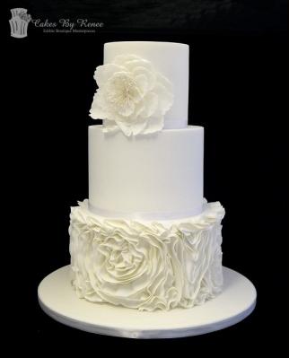 3 tier white on white texture flower rosettes wedding cake.png