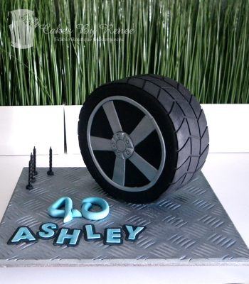 upright mag wheel cake 40th birthday cake tyre boys mens.png