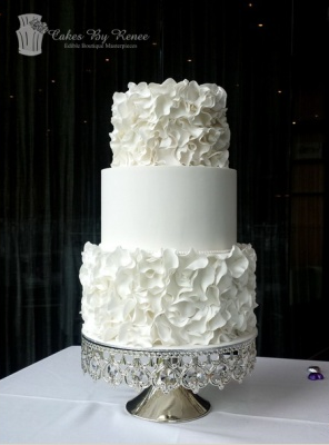 3 tier white on white wedding cake ruffles bling stand cakesbyrenee.png
