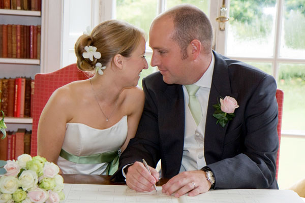 Gillian & Nigel signing the register
