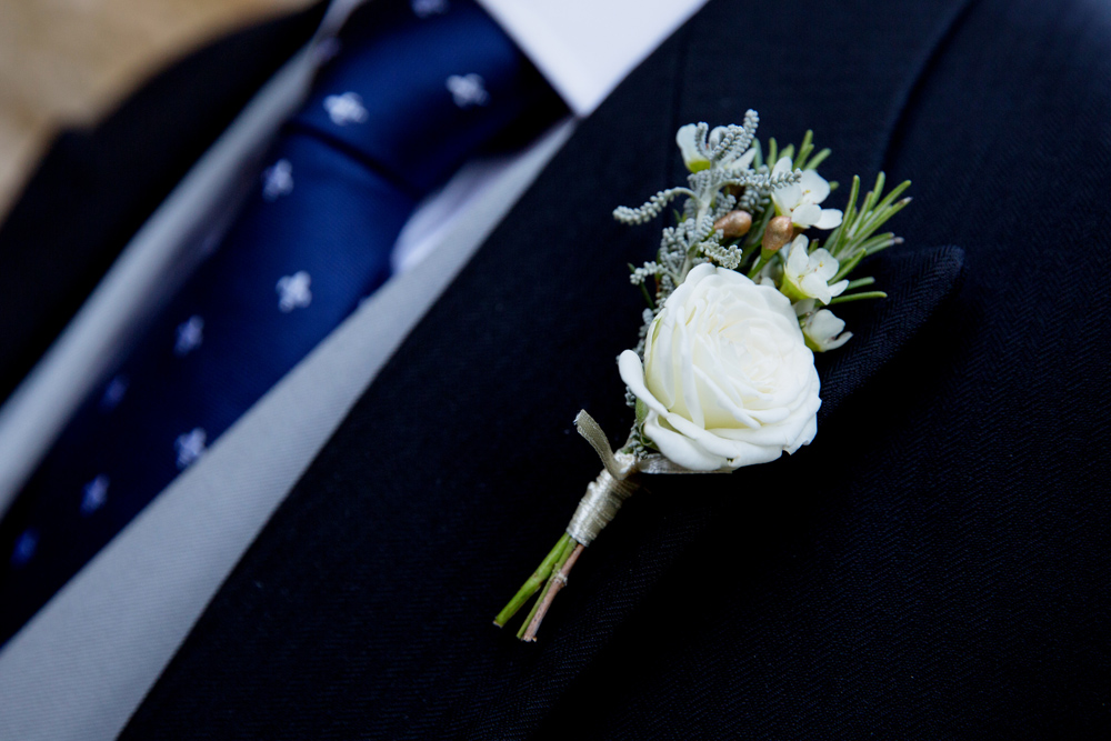 button hole - winter wedding at Hoath House by Helen England Photography, Kent