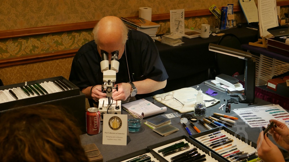 Jim Rouse checking the nibs with a microscope no less.