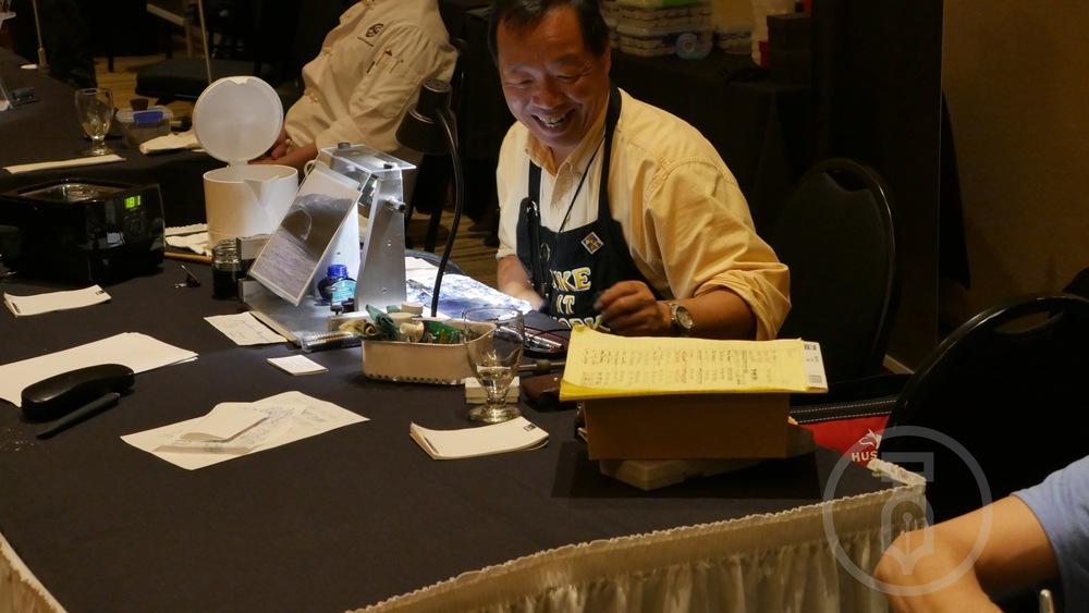 Mike Masuyama working hard & enjoying the attendees