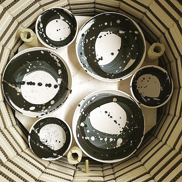 I realised I hardly ever show the bowls at this stage, and I don't know why I don't because I love the nearly-black colour of them after bisque firing. So here they are, ready to have their bases waxed for glazing. Nothing like a commission with a deadline to chivvy you along..! 😬  #sallyjodesign #swooshbowls #handmadeceramics #uniquetableware #loveclay #pottersofinstagram