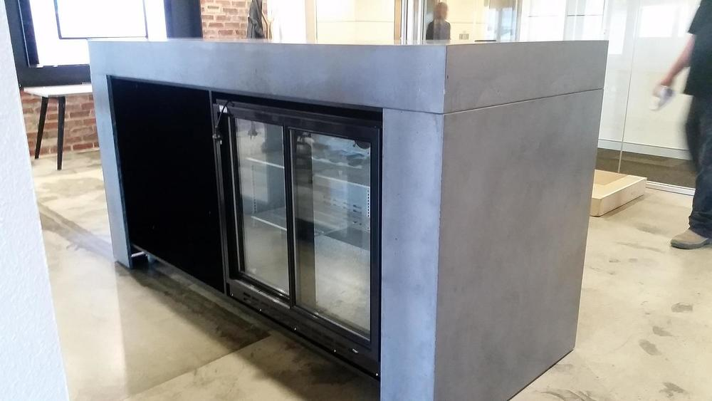 concrete reception benchtop with fridge
