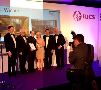 From left David Snodgrass, Noel James &Karl Pedersen (Mullarkey Pedersen Architects) & Helen Quigley (Inner City Trust)accepting the award in Belfast last Thursday evening with broadcaster Paul Clark.