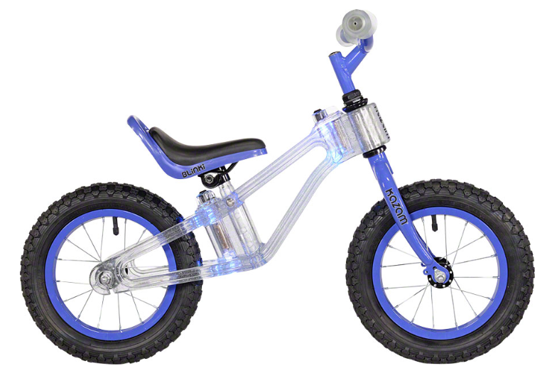 KaZAM BLinki 12   Children everywhere will glow with delight riding the KaZAM Blinki Bike featuring a super strong frame made of space-age clear polycarbonate material that lights up in multi-colored LED lights.
