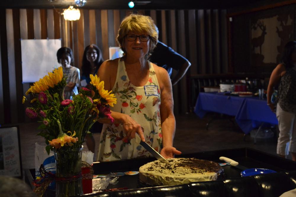 Gretchen Stangl Charlton serving cake