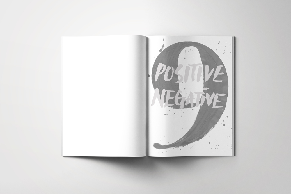 "The first page of the magazine is translucent with white ""Positive Negative"" printed on it, the page after it is a black 9."