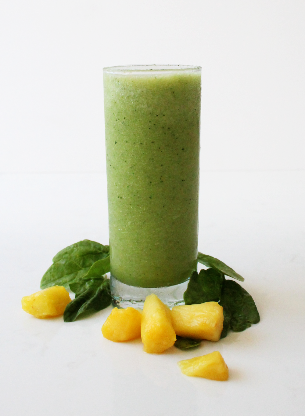 Green Tropical Get your greens with this tropical infused smoothie! Generous amounts of spinach are blended with pineapple, coconut milk, ginger, hemp seeds, and lime to make this healthy and deliciously flavored drink reminiscent of a tropical getaway. --- spinach, pineapple, banana, hemp seed, coconut milk, cold-pressed pineapple juice, cold-pressed ginger juice, lime juice