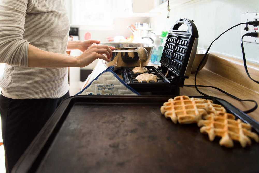 Mom making waffles at home during family photo session