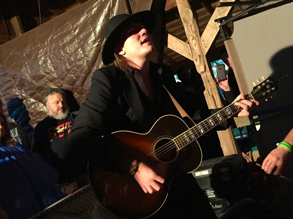 Dylan playing in the barn during the storm at the 2016 Luck Reunion. Photo By: Al Giesler