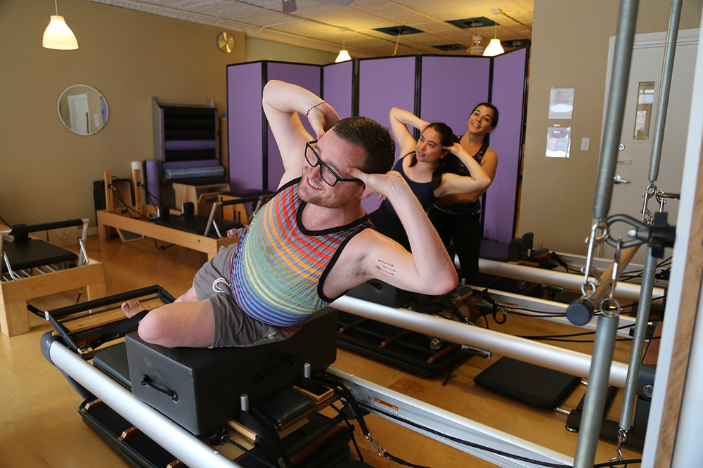 Teaching side sit-up on the Reformer