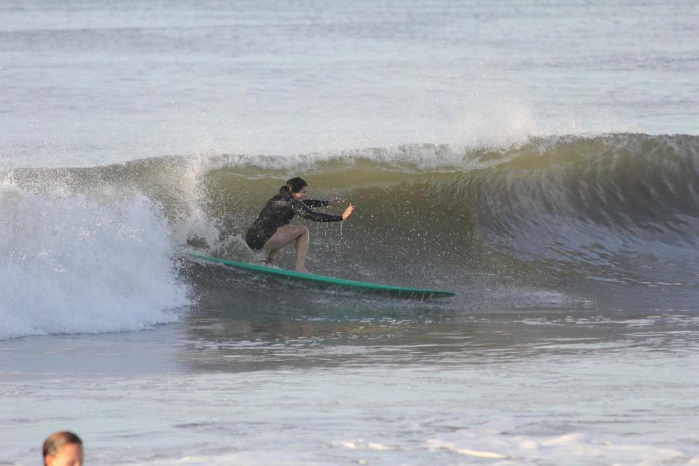 Kim catching a wave