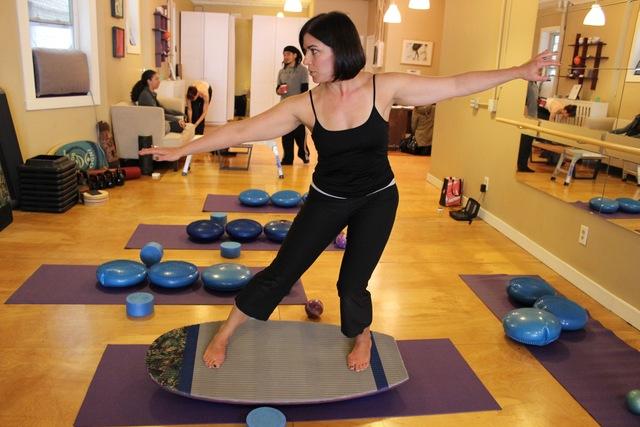 Kim balancing on a Surfilates board