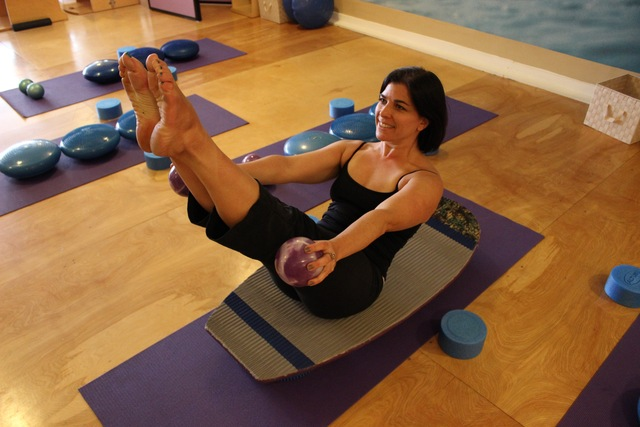 Pilates teaser on a Surfilates board
