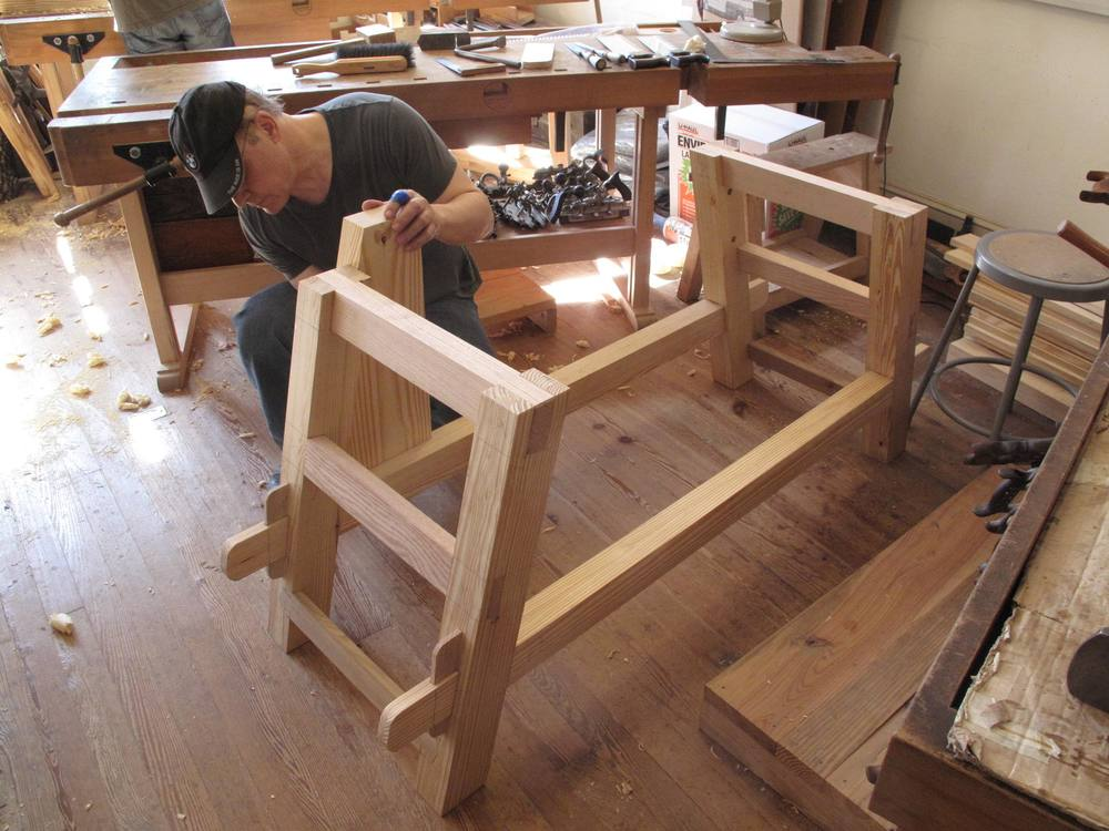 Student makes bench frame.jpg