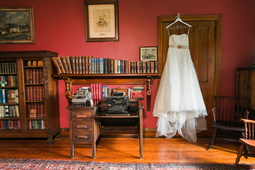 Wedding Dress Hanging in Historic Room