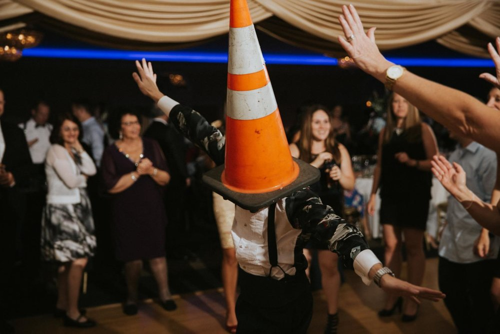 NJ Vinyard Wedding Reception Cone on Head Groom.JPG