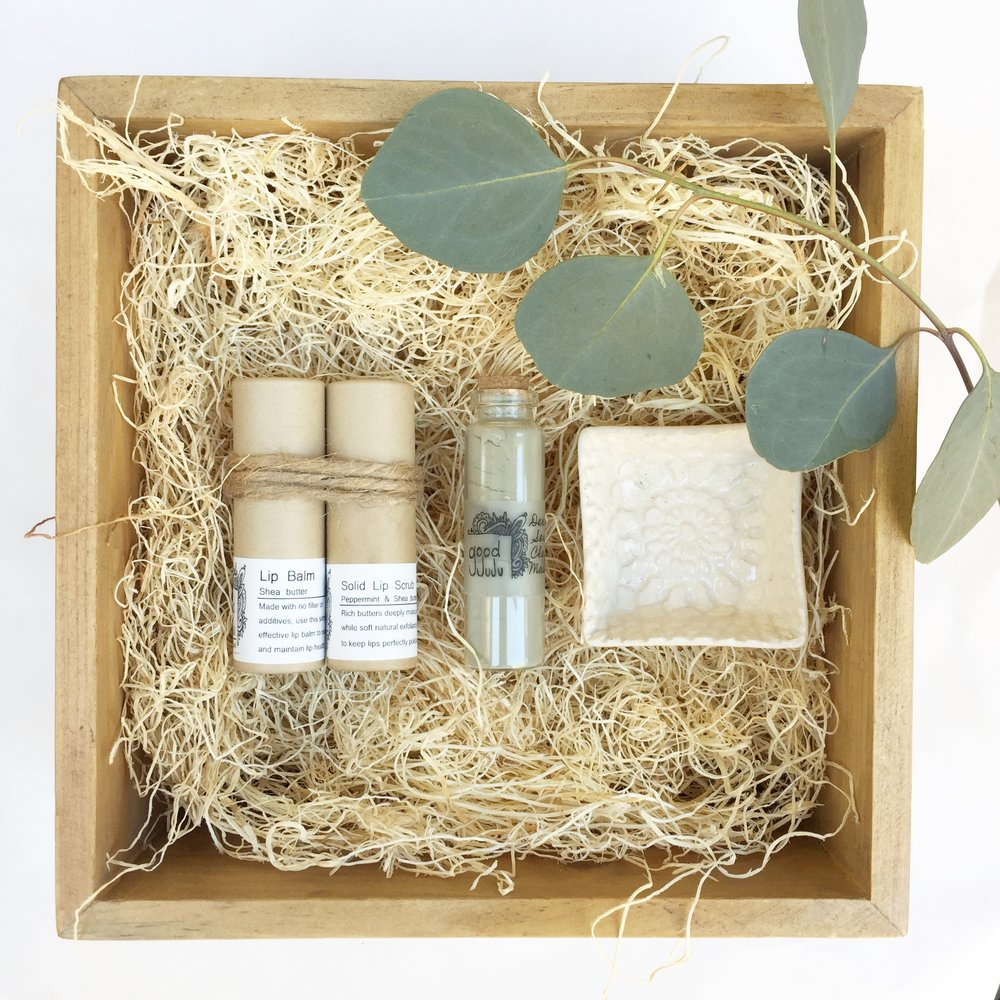 "This Set comes with a Solid Lip Scrub and Lip Balm duo, Dead Sea Clay Face mask and handmade face mask dish by local artist Lauren Sumner.  This Gift Set says ""Hey, i'm not exactly sure what to buy you but this will look nice next to the sink and everyone loves to be pampered and have soft lips and skin so Merry Christmas"" ($35)"