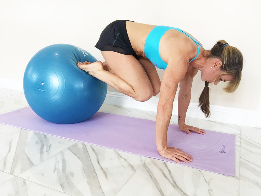 Performing push ups on an unstable surface such as a physio ball forces your to work your stabilizers and engage your core.