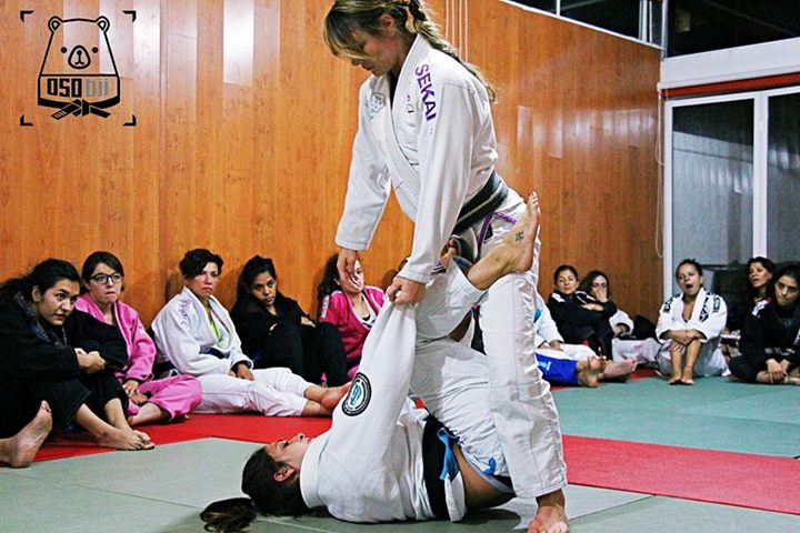 Demonstrating BJJ techniques with mackenzie Dern. Photo courtesy of Osu.