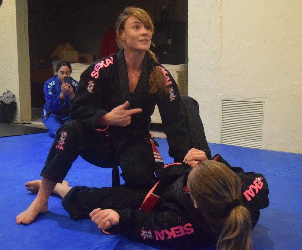 I am teaching class and demonstrating on fellow black belt Christina Barry