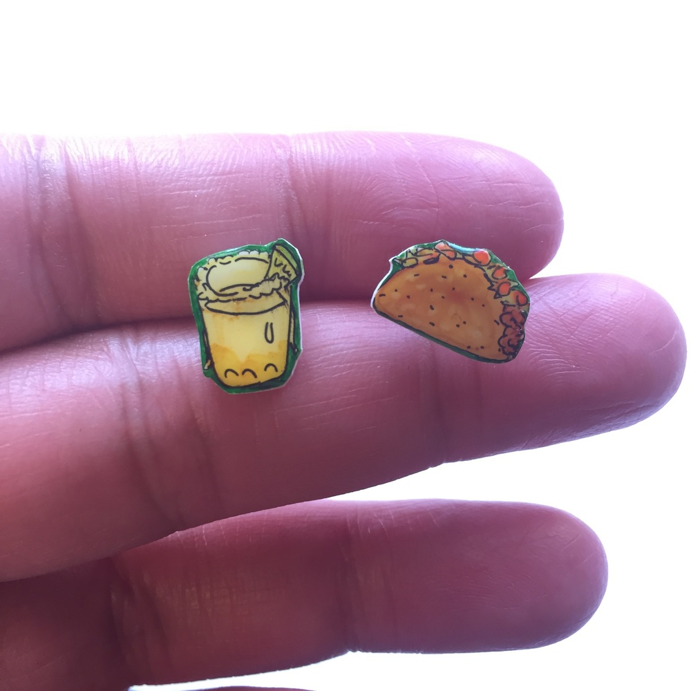 "Excerpt of my listing for these taco Tuesday earrings:   ""Illustrate your ears!  These shrink plastic button stud earrings make a unique gift for your sister, best friend, niece, mother, yourself, etc.!  Taco Tuesday!!  Everyone's favorite day of the week! celebrate it in style, while you chomp on tacos & sip margaritas!  Each design is hand drawn on shrink plastic, sealed with a clear coating and affixed to nickel-free earring posts"""