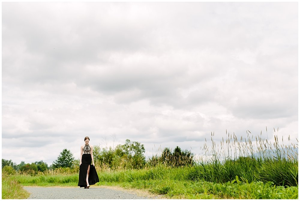 abbotsford-british-columbia- prom photographer- graduation photographer- walking in prom gown down trail in grass field-claudia-wyler-photography