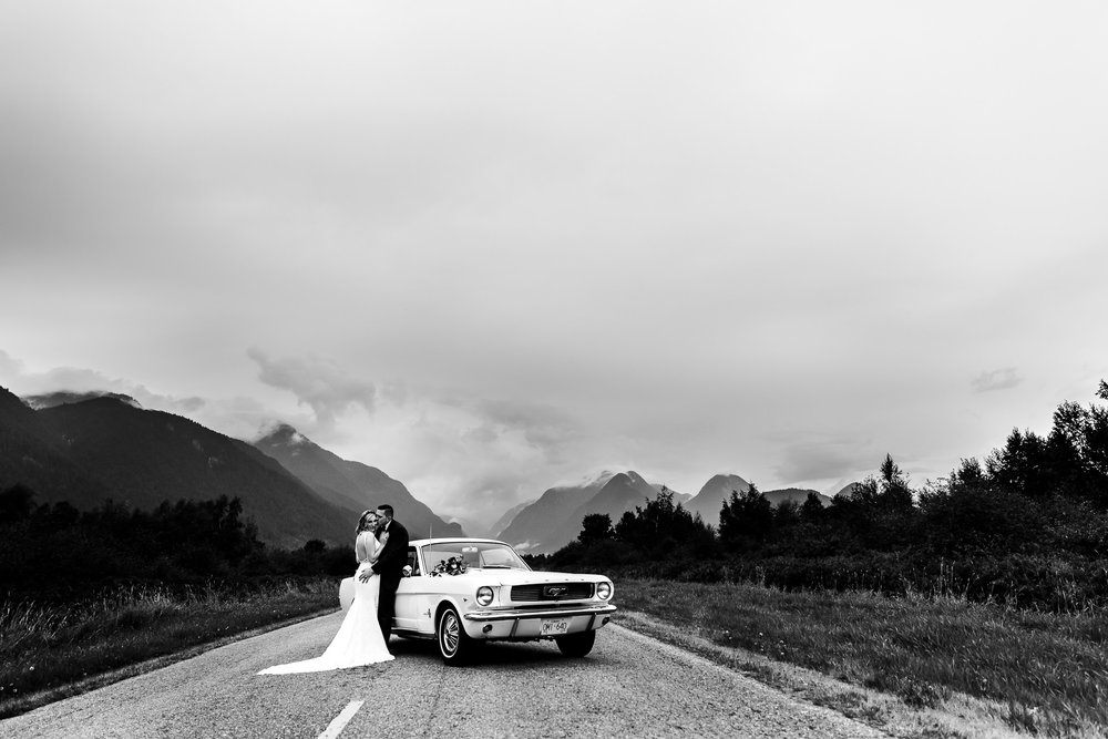 Bride and Groom kissing on gravel road