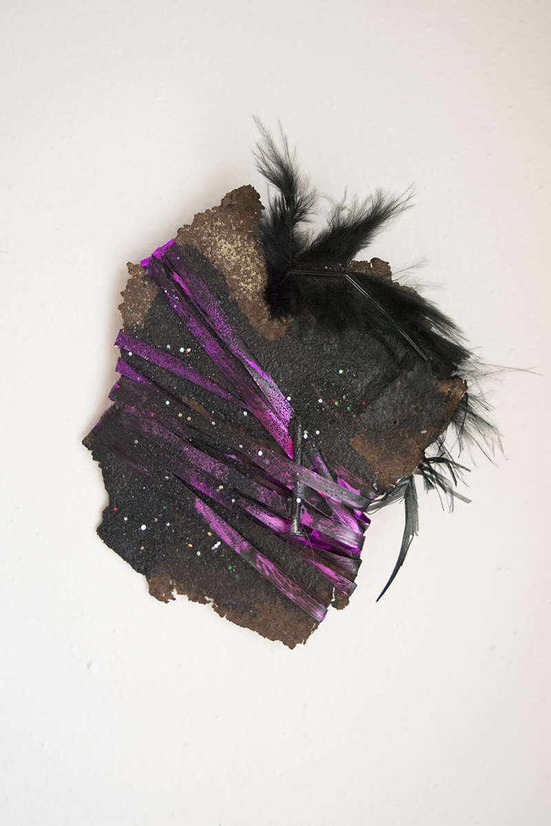 "Acrylic on Rusted Metal, Ribbon, Nail, Feather, and Glitter  5""x4""  2016"