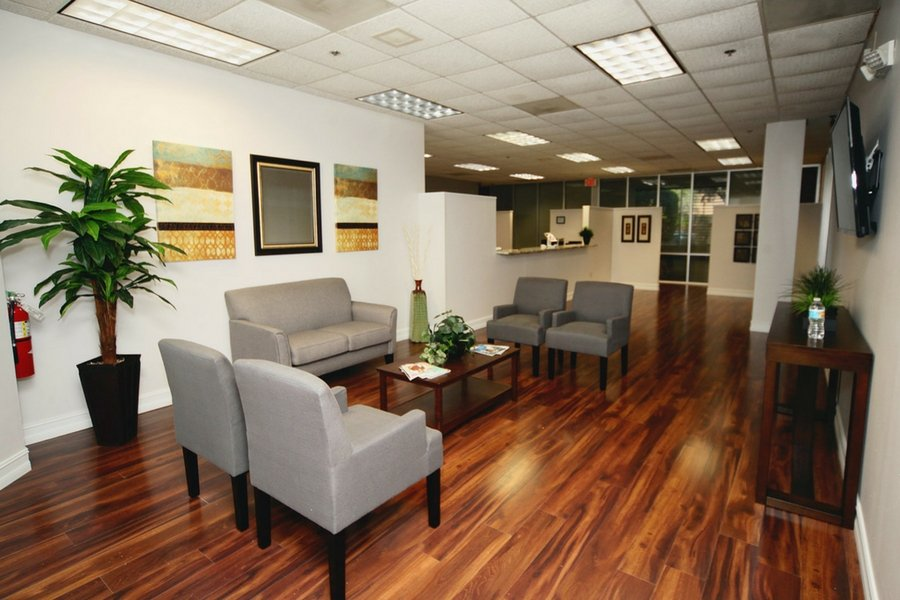 sk retina's lobby with rich hardwood floors and relaxing decor make patients feel at ease.