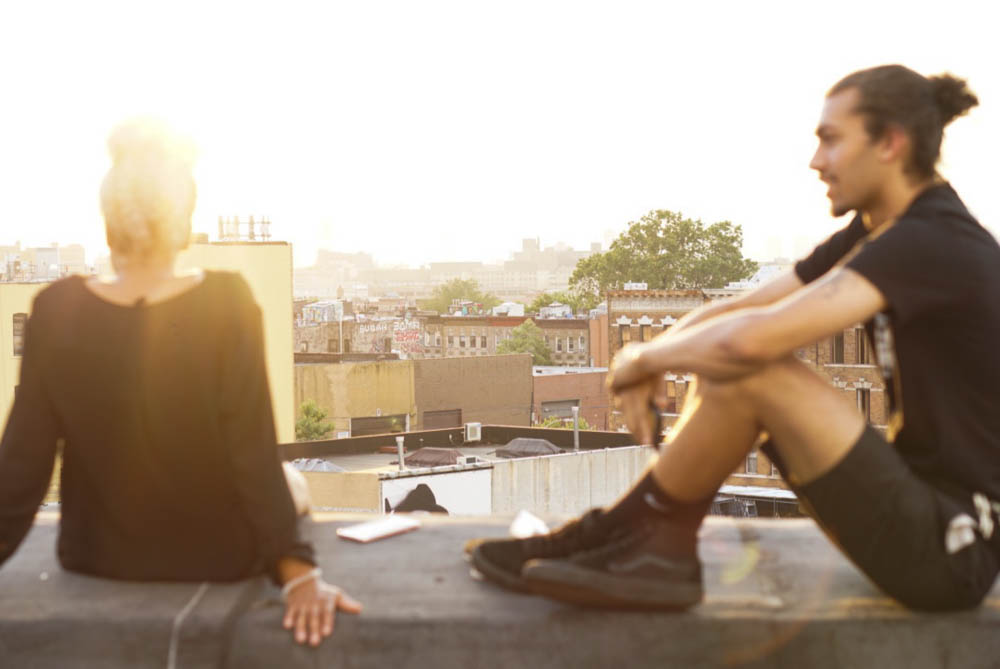 Kassala, Austin and I enjoying a sunset on a NYC rooftop last June.