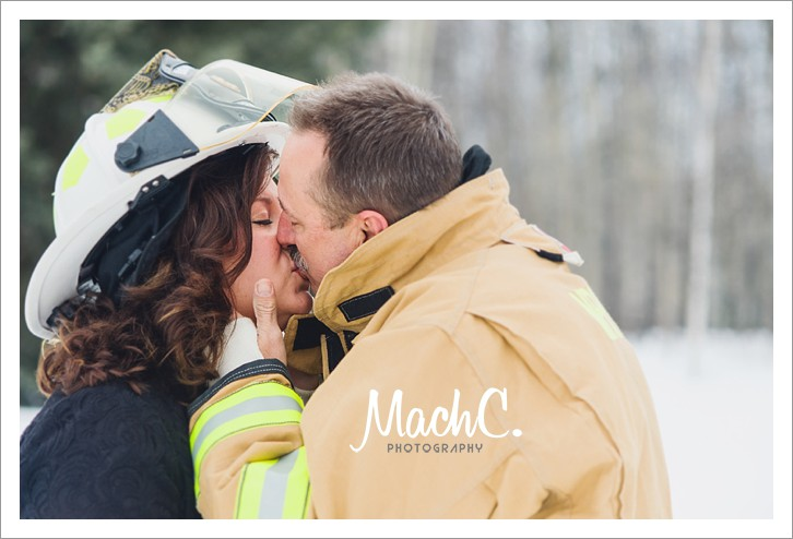 a beautiful kiss in the great outdoors between the fireman and his wife