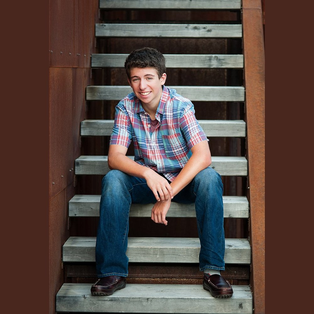 Teen Boy photoshoot on modern steps that combine wood and metal.